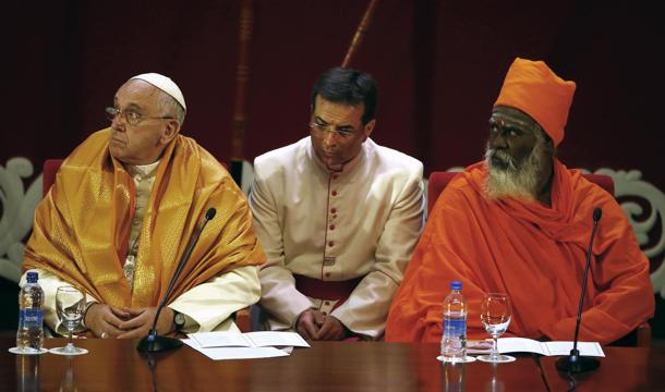 Pope Francis sits with Hindu Ndu-Kurukkal SivaSri T. Mahadeva during the Interreligious Encounter at the Bmich in Colombo